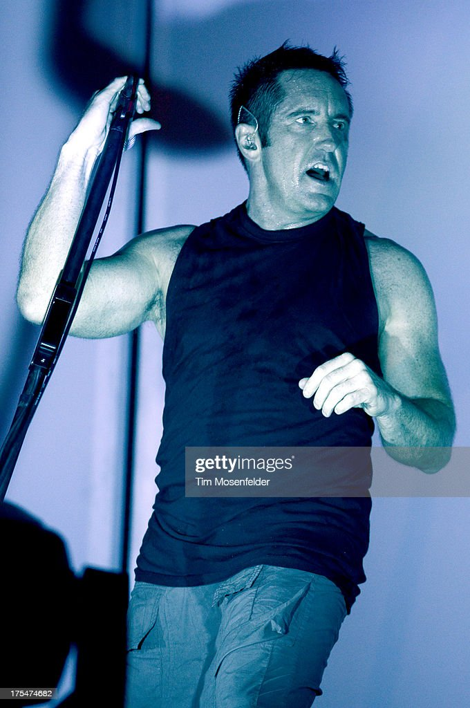 <a gi-track='captionPersonalityLinkClicked' href=/galleries/search?phrase=Trent+Reznor&family=editorial&specificpeople=239036 ng-click='$event.stopPropagation()'>Trent Reznor</a> of Nine Inch Nails performs at Lollapalooza 2013 at Grant Park on August 2, 2013 in Chicago, Illinois.