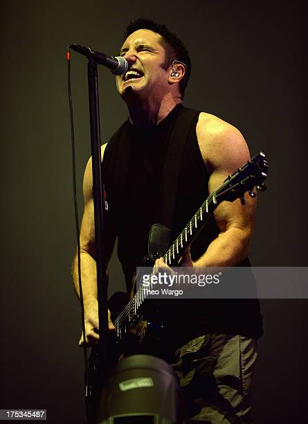 Trent Reznor of Nine Inch Nails performs during Lollapalooza 2013 at Grant Park on August 2 2013 in Chicago Illinois