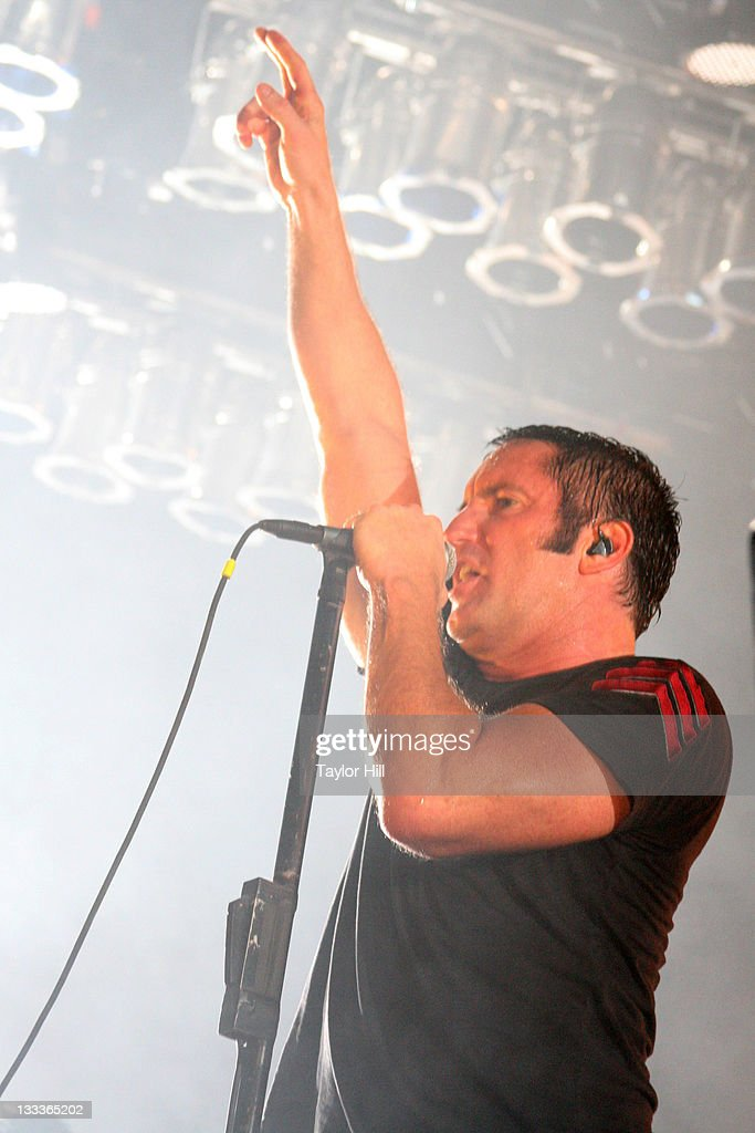 <a gi-track='captionPersonalityLinkClicked' href=/galleries/search?phrase=Trent+Reznor&family=editorial&specificpeople=239036 ng-click='$event.stopPropagation()'>Trent Reznor</a> of <a gi-track='captionPersonalityLinkClicked' href=/galleries/search?phrase=Nine+Inch+Nails&family=editorial&specificpeople=799973 ng-click='$event.stopPropagation()'>Nine Inch Nails</a> performs on May 10, 2009 in Atlanta, Georgia.
