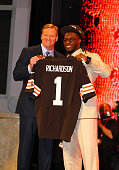 Trent Richardson from Alabama holds up a jersey as he stands on stage with NFL Commissioner Roger Goodell after he was selected overall by the...
