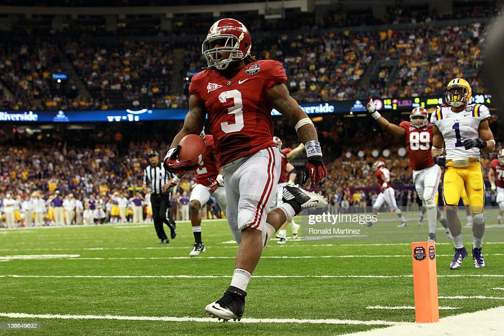 <a gi-track='captionPersonalityLinkClicked' href=/galleries/search?phrase=Trent+Richardson&family=editorial&specificpeople=5653463 ng-click='$event.stopPropagation()'>Trent Richardson</a> #3 of the Alabama Crimson Tide celebrates after scoring a touchdown in the fourth quarter against the Louisiana State University Tigers during the 2012 Allstate BCS National Championship Game at Mercedes-Benz Superdome on January 9, 2012 in New Orleans, Louisiana.