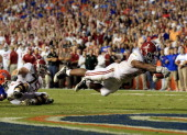 Trent Richardson of the Alabama Crimson Tide dives for a touchdown during a game against the Florida Gators at Ben Hill Griffin Stadium on October 1...
