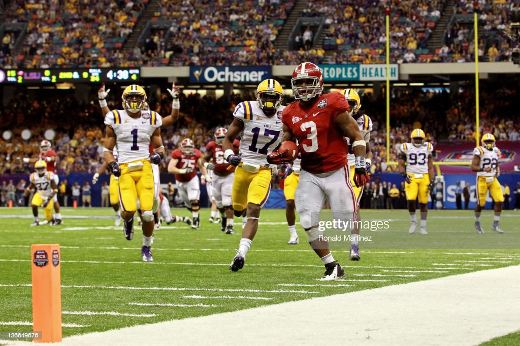 <a gi-track='captionPersonalityLinkClicked' href=/galleries/search?phrase=Trent+Richardson&family=editorial&specificpeople=5653463 ng-click='$event.stopPropagation()'>Trent Richardson</a> #3 of the Alabama Crimson Tide runs for a 34 yard touchdown in the fourth quarter against Morris Claiborne #17 of the Louisiana State University Tigers during the 2012 Allstate BCS National Championship Game at Mercedes-Benz Superdome on January 9, 2012 in New Orleans, Louisiana.