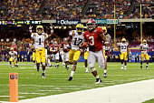 Trent Richardson of the Alabama Crimson Tide runs for a 34 yard touchdown in the fourth quarter against Morris Claiborne of the Louisiana State...