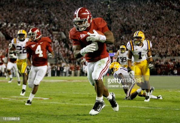 Trent Richardson of the Alabama Crimson Tide runs with the ball during the first half of the game against the LSU Tigers at BryantDenny Stadium on...