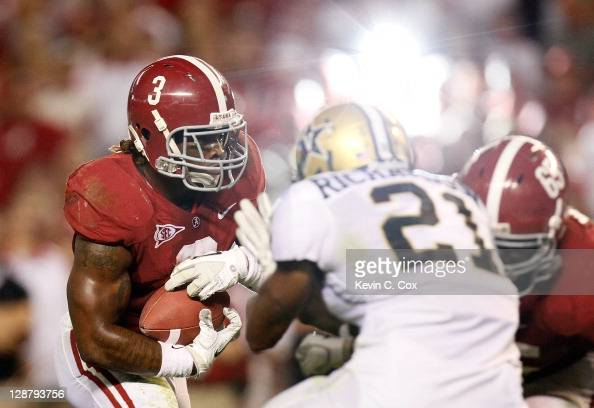 Trent Richardson of the Alabama Crimson Tide rushes upfield against the Vanderbilt Commodores at BryantDenny Stadium on October 8 2011 in Tuscaloosa...