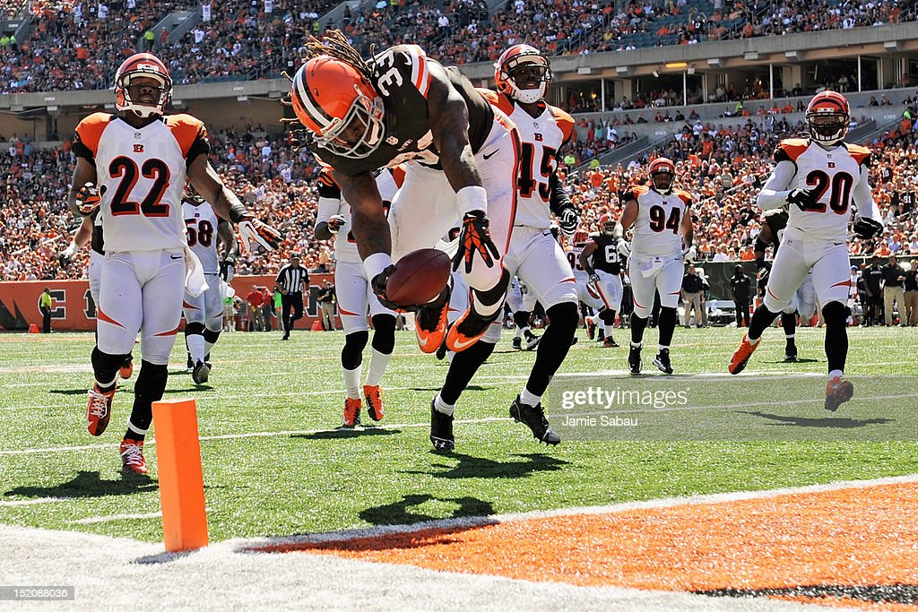 <a gi-track='captionPersonalityLinkClicked' href=/galleries/search?phrase=Trent+Richardson&family=editorial&specificpeople=5653463 ng-click='$event.stopPropagation()'>Trent Richardson</a> #33 of the Cleveland Browns flips into the endzone at the end of a 32-yard touchdown run in the first half against the Cincinnati Bengals at Paul Brown Stadium on September 16, 2012 in Cincinnati, Ohio.