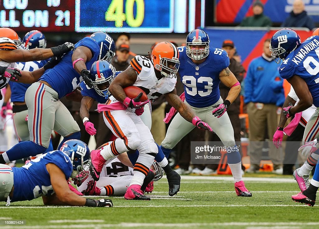 Trent Richardson of the Cleveland Browns in action against Prince Amukamara and Chase Blackburn of the New York Giants at MetLife Stadium on October...