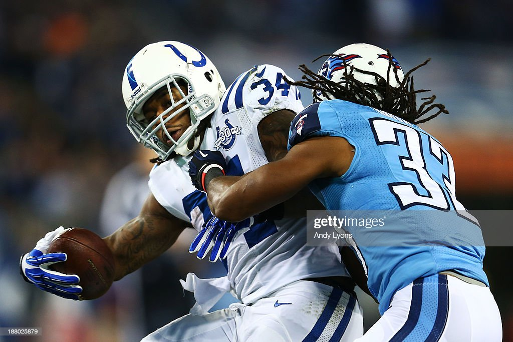 <a gi-track='captionPersonalityLinkClicked' href=/galleries/search?phrase=Trent+Richardson&family=editorial&specificpeople=5653463 ng-click='$event.stopPropagation()'>Trent Richardson</a> #34 of the Indianapolis Colts carries the ball against the defense of Michael Griffin #33 of the Tennessee Titans in the second quarter at LP Field on November 14, 2013 in Nashville, Tennessee.