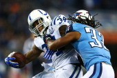 Trent Richardson of the Indianapolis Colts carries the ball against the defense of Michael Griffin of the Tennessee Titans in the second quarter at...