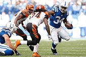 Trent Richardson of the Indianapolis Colts carries the ball during the game against the Cincinnati Bengals on October 19 2014 at Lucas Oil Stadium on...
