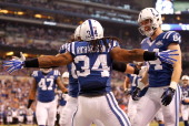 Trent Richardson of the Indianapolis Colts celebrates a first quarter touchdown with Jack Doyle while playing the Jacksonville Jaguars at Lucas Oil...