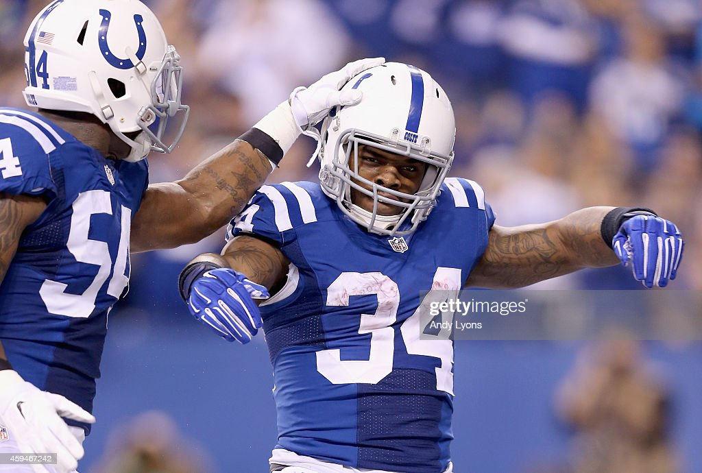 <a gi-track='captionPersonalityLinkClicked' href=/galleries/search?phrase=Trent+Richardson&family=editorial&specificpeople=5653463 ng-click='$event.stopPropagation()'>Trent Richardson</a> #34 of the Indianapolis Colts celebrates with Andrew Jackson #54 after running for a touchdown during the game against the Jacksonville Jaguars at Lucas Oil Stadium on November 23, 2014 in Indianapolis, Indiana.