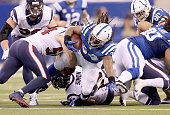 Trent Richardson of the Indianapolis Colts dives for extra yards during the 1710 win over the Houston Texans at Lucas Oil Stadium on December 14 2014...