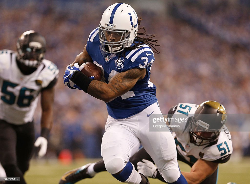 <a gi-track='captionPersonalityLinkClicked' href=/galleries/search?phrase=Trent+Richardson&family=editorial&specificpeople=5653463 ng-click='$event.stopPropagation()'>Trent Richardson</a> #34 of the Indianapolis Colts runs for a fist quarter touchdown through the tackle of <a gi-track='captionPersonalityLinkClicked' href=/galleries/search?phrase=Paul+Posluszny&family=editorial&specificpeople=2089891 ng-click='$event.stopPropagation()'>Paul Posluszny</a> #51 of the Jacksonville Jaguars at Lucas Oil Stadium on December 29, 2013 in Indianapolis, Indiana.