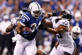 Trent Richardson of the Indianapolis Colts runs the ball in the first half of the game against the Philadelphia Eagles at Lucas Oil Stadium on...
