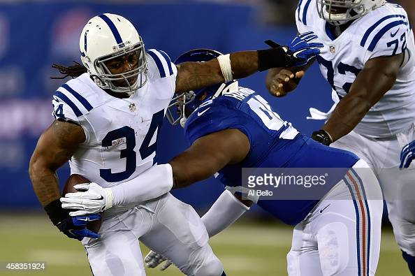 Trent Richardson of the Indianapolis Colts runs the ball in the first quarter against the New York Giants during their game at MetLife Stadium on...