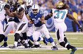 Trent Richardson of the Indianapolis Colts runs with the ball during the game against the Jacksonville Jaguars at Lucas Oil Stadium on November 23...