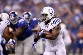 Trent Richardson of the Indianapolis Colts runs with the ball in the first half of an NFL preseason game against the New York Giants at Lucas Oil...