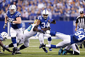 Trent Richardson of the Indianapolis Colts runs with the ball in the first half of the game against the Jacksonville Jaguars at Lucas Oil Stadium on...
