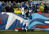 Trent Richardson of the Indianapolis Colts signs autographs after the game against the Tennessee Titans at LP Field on December 28 2014 in Nashville...