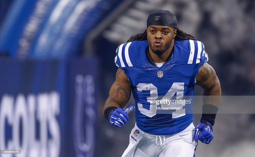 <a gi-track='captionPersonalityLinkClicked' href=/galleries/search?phrase=Trent+Richardson&family=editorial&specificpeople=5653463 ng-click='$event.stopPropagation()'>Trent Richardson</a> #34 of the Indianapolis Colts takes the field during player introductions before the game against the Houston Texans at Lucas Oil Stadium on December 14, 2014 in Indianapolis, Indiana.