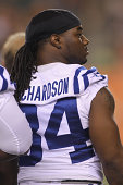 Trent Richardson of the Indianapolis Colts watches his teammates from the bench during the game against the Cincinnati Bengals at Paul Brown Stadium...