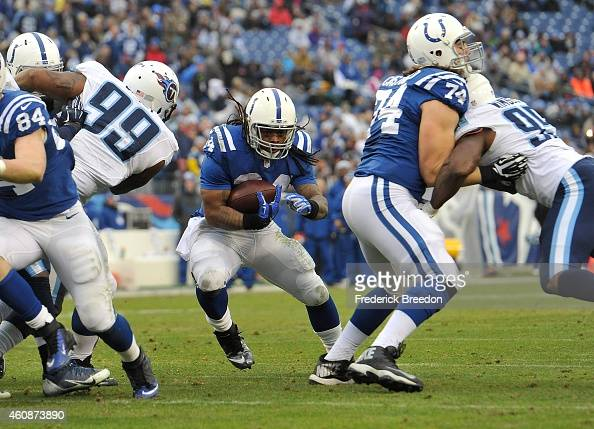 Trent Richardson rushes against the Tennessee Titans during the second quarter of a game at LP Field on December 28 2014 in Nashville Tennessee