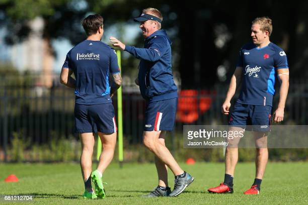 Trent Robinson head coach of the Roosters talks to Mitchell Pearce during a Sydney Roosters NRL training session at Kippax Lake on May 10 2017 in...