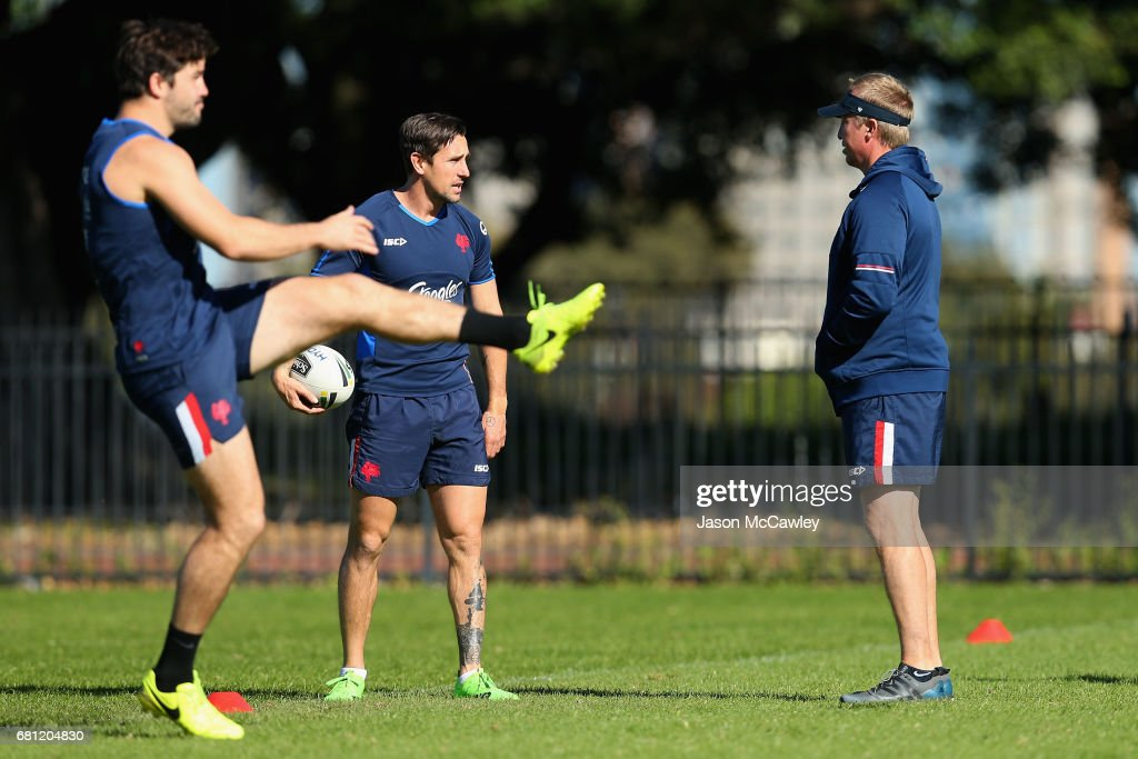 Trent Robinson head coach of the Roosters tals to Mitchell Pearce during a Sydney Roosters NRL training session at Kippax Lake on May 10, 2017 in Sydney, Australia.