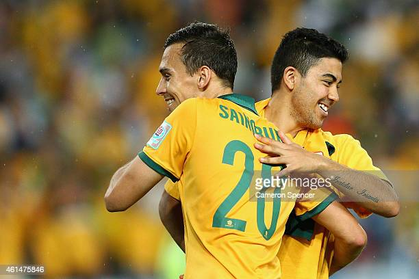 Trent Sainsbury and Massimo Luongo celebrate winning the 2015 Asian Cup match between Oman and Australia at ANZ Stadium on January 13 2015 in Sydney...