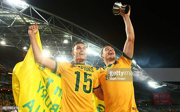 Trent Sainsbury and Mathew Leckie of Australia celebrate after winning the 2015 Asian Cup final match between Korea Republic and the Australian...