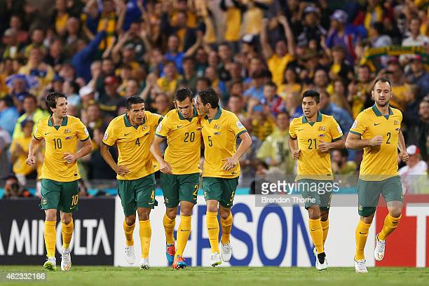 Trent Sainsbury of Australia celebrates with team mates after scoring a goal during the Asian Cup Semi Final match between the Australian Socceroos...