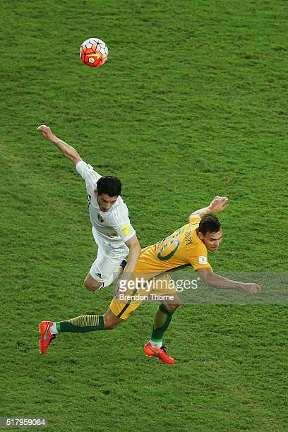 Trent Sainsbury of Australia competes with Ayed of Jordan during the 2018 FIFA World Cup Qualification match between the Australian Socceroos and...