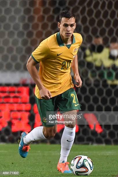 Trent Sainsbury of Australia dribbles the ball during the international friendly match between Japan and Australia at Nagai Stadium on November 18...
