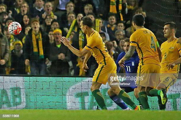 Trent Sainsbury of Australia heads the ball to score a goal during the International Friendly match between the Australian Socceroos and Greece at...