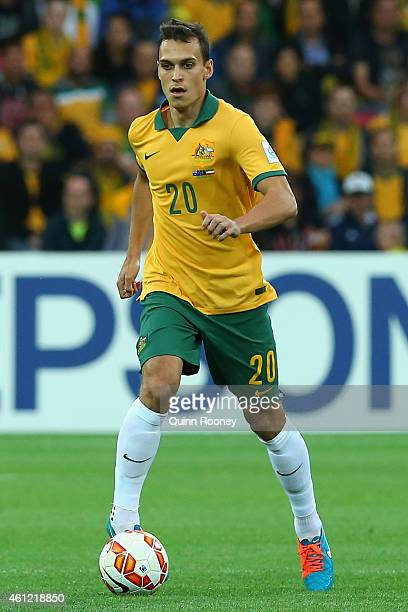 Trent Sainsbury of Australia looks to pass the ball during the 2015 Asian Cup match between the Australian Socceroos and Kuwait at AAMI Park on...