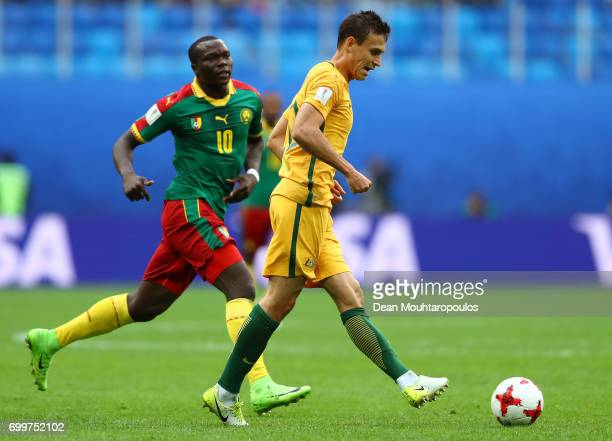 Trent Sainsbury of Australia takes the ball past Vincent Aboubakar of Cameroon during the FIFA Confederations Cup Russia 2017 Group B match between...