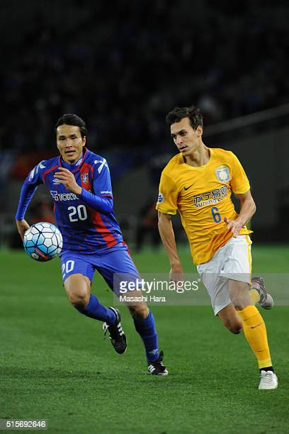 Trent Sainsbury of Jiangsu Suning FC and Ryoichi Maeda of FC Tokyo compete for the ball during the AFC Champions League Group E match between FC...