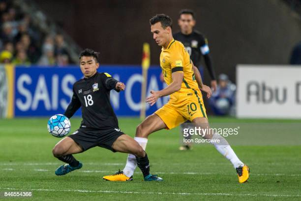 Trent Sainsbury of the Australian National Football Team and Chanathip Songkrasin of the Thailand National Football Team contest the ball during the...