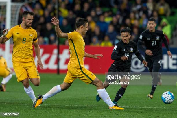 Trent Sainsbury of the Australian National Football Team clears the ball before a contest with Chanathip Songkrasin of the Thailand National Football...