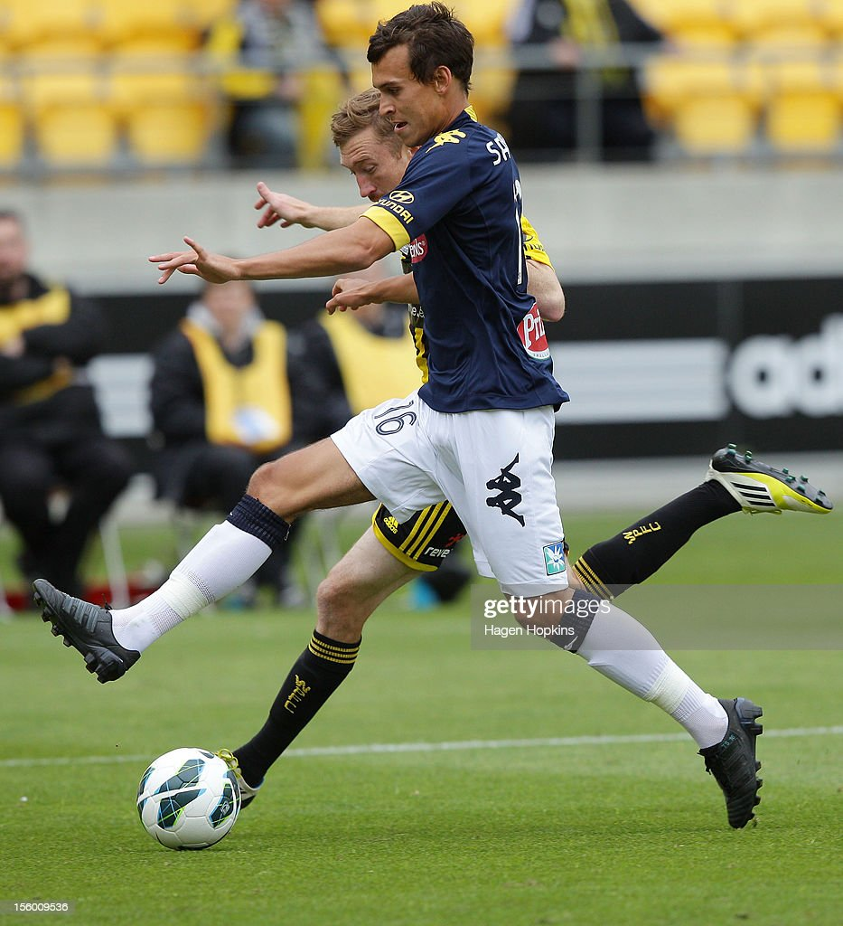 Trent Sainsbury of the Mariners and Alexander Smith of the Phoenix compete for the ball during the round six A-League match between the Wellington Phoenix and the Central Coast Mariners at Westpac Stadium on November 11, 2012 in Wellington, New Zealand.