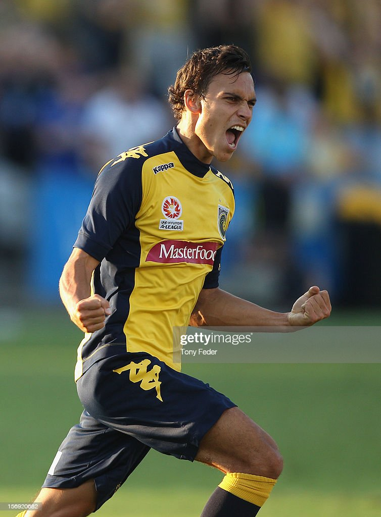 Trent Sainsbury of the Mariners celebrates a team mates goal during the round eight A-League match between the Central Coast Mariners and the Brisbane Roar at at Bluetongue Stadium on November 25, 2012 in Gosford, Australia.