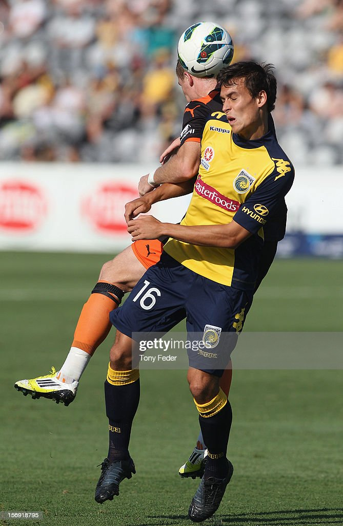 Trent Sainsbury of the Mariners heads the ball away during the round eight A-League match between the Central Coast Mariners and the Brisbane Roar at at Bluetongue Stadium on November 25, 2012 in Gosford, Australia.