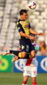 Trent Sainsbury of the Mariners heads the ball during the round 13 ALeague match between the Central Coast Mariners and the Melbourne Heart at...