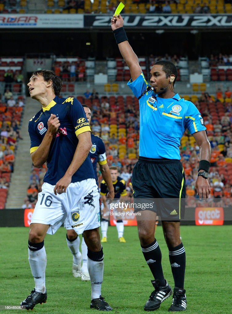 Trent Sainsbury of the Mariners is given a yellow card by referee Lucien Laverdure during the round 19 A-League match between the Brisbane Roar and the Central Coast Mariners at Suncorp Stadium on February 1, 2013 in Brisbane, Australia.