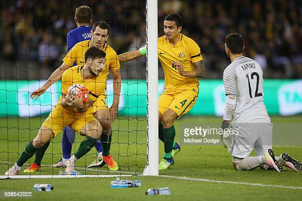 Trent Sainsbury of the Socceroos celebrates a goal with Ryan McGowan and Tim Cahill during the International Friendly match between the Australian...