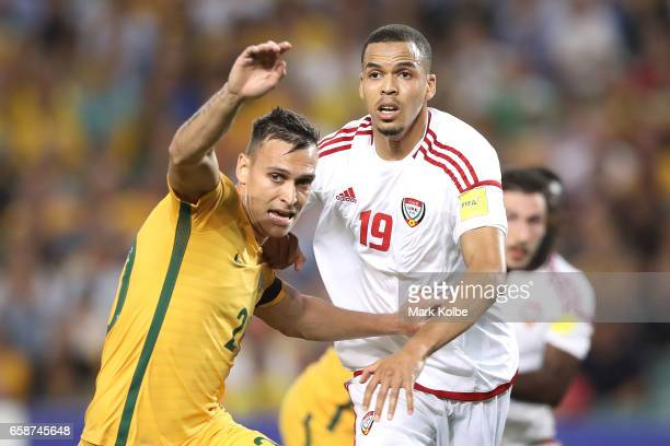 Trent Sainsbury of the Socceroos is put under pressure by Ismail Ahmed of the United Arab Emirates during the 2018 FIFA World Cup Qualifier match...