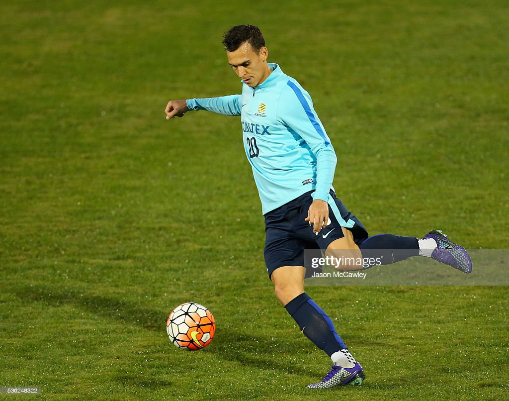 <a gi-track='captionPersonalityLinkClicked' href=/galleries/search?phrase=Trent+Sainsbury&family=editorial&specificpeople=5622355 ng-click='$event.stopPropagation()'>Trent Sainsbury</a> of the Socceroos kicks during an Australian Socceroos training session at Leichhardt Oval on June 1, 2016 in Sydney, Australia.