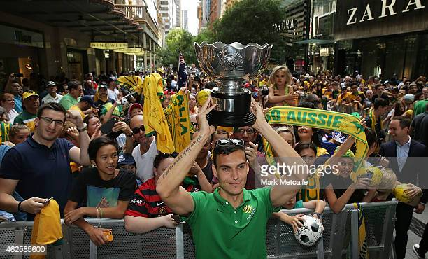 Trent Sainsbury poses with the Asian Cup during celebrations at Westfield Sydney on February 1 after the Socceroos won the 2015 Asian Cup last night...